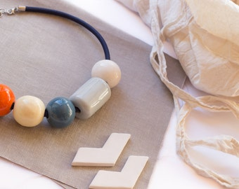 Statement necklace. Ceramic necklace gray, orange, white and blue. Blue electrical cable