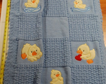 Appliqued knitted baby blanket