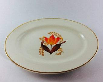 1940s Bakerite orange tulip ceramic serving platter with gold rim