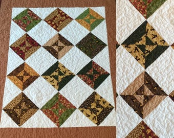 "Handmade baby quilt throw featuring bears and blossoms in rich browns  39"" x 49"""