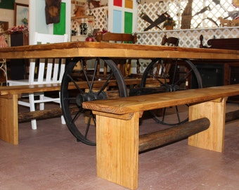 Rustic Pine Table with Wagon Wheel Base
