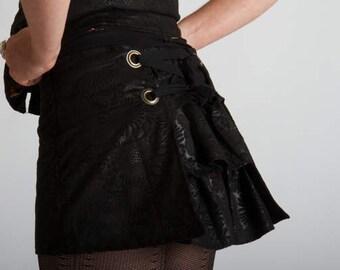 JUDITH ultra mini bustle skirt black shiny suedine