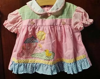 Little baby girl 80's dress, little yellow bird singing to the sun rise.