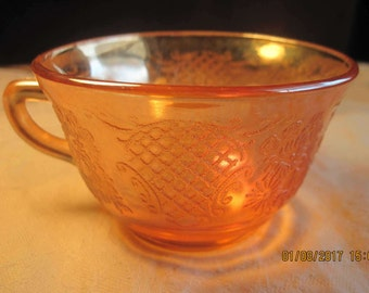 Normandie carnival glass iridescent orange teacup with lattice and bouquet pattern