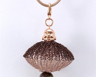 wire crochet UFO pendant with buddha and pearl on a leatherband
