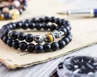 8mm - Double wrap matte black onyx beaded double silver skull and a tiger eye bead stretchy bracelet, mens bracelet, womens bracelet