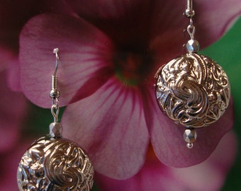 Silver floral round very attractive earrings