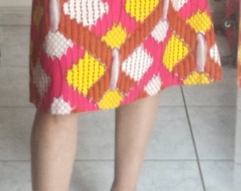Skirt flared in wax yellow, pink, orange