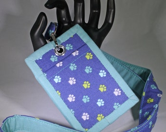 Lanyard & Matching ID Badge Holder. Animal dog paw prints. Turquoise/teal green blue. Optional break away buckle.