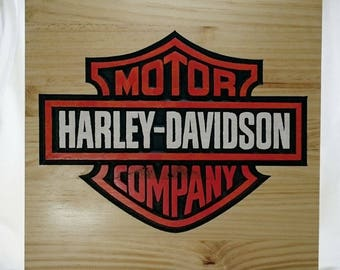 Recorded pine poster with the Harley logo