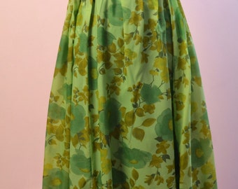 1960s green floral vintage dress beautifully handmade and fully lined. A great summer dress