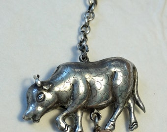 Antique Chinese silver ox talisman