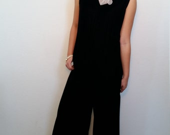 70's black velvet jumpsuit. White pleated collar. Romper. One piece. Size Small or Medium.