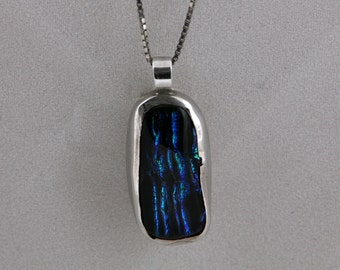 silver pendant with dichroic glass.