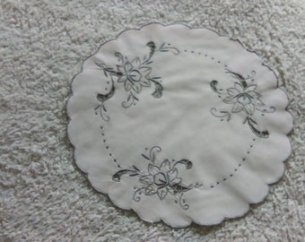 White doily and grey embroidery