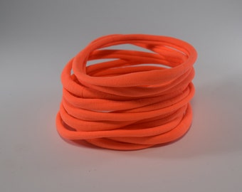 nylon headbands,NEON ORANGE nylon headbands,nylon bands,one size fits most headbands,nylon bands, wholesale nylon headbands,stretchy elastic
