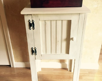 Distressed Beadboard Cupboard