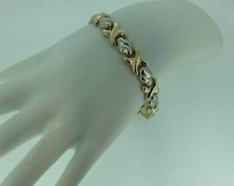 "14kt Yellow and White Gold Lady's  7"" Bracelet that is bright and shiny."