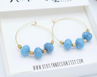 Blue Glass Faceted Matte Gold Toned Hoops