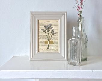 framed pressed flowers on antique book page - light grey + lavender