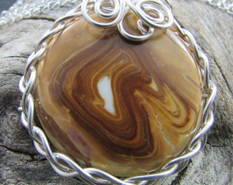 Handmade petrified wood sterling silver wrapped necklace.
