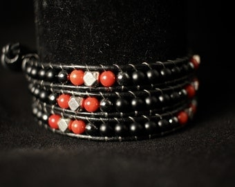 Black leather triple wrap bracelet made from black onyx, red coral and hematite with silver nuggets
