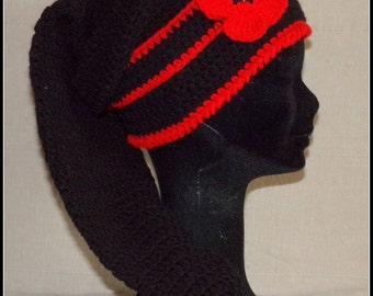 black and Red Elf Hat embellished with a flower with a fairy in the Center