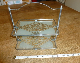 Chrome and glass stand
