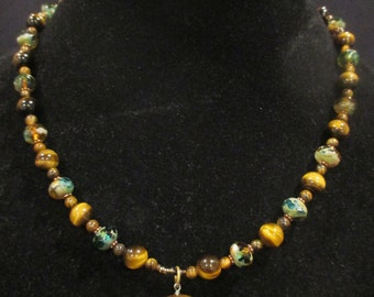 Tigers eye bear pendant necklace with blue czech beads and copper