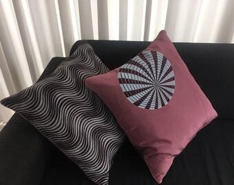 2 handmade pillows made from fashion fabrics