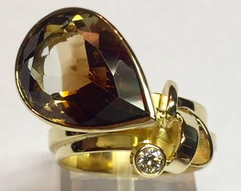 Ring in yellow gold (18 k) set with Brown Topaz and brilliant