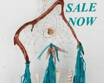 Unique Turquoise leather Dreamcatcher on  wood with shells