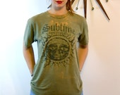 Vintage Sublime 90s Punk Ska Rock Band T-Shirt Thrashed Distressed Holes Ripped Army Green Long Beach CA Sun Logo 1990s Six Fifty One Tee