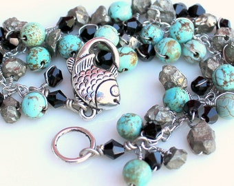 fish and pyrite bracelet. giving back to the earth. wire wrapped teal gemstones and swarovski. handmade by uniquenecks
