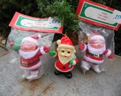 Santa ornaments set of 3 vintage oranments 2 NOS in original package, flocked/felted one labeled Thailand one is all plastic made Japan