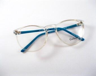 Circular eyeglasses frames. Clear blue plastic oversized 80s 90s new old stock / deadstock / NOS. no lenses.