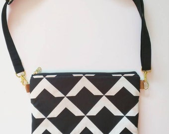 Black and white geometric triangle print with teal floral interior