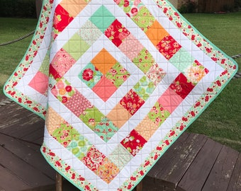 "Red, Orange, Pink, Aqua and More Altogether In This 43.75"" X 43.75"" Quilt In The Line Called Scrumptious By Bonnie & Camille For Moda Fabric"