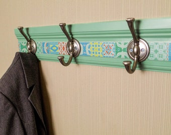 Coat Rack or Towel Rack . 3 brushed silver hooks on this Jade colored rack with boho tile design .