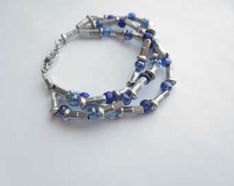 Recycled Bicycle Jewelry , Three Strand Brushed Aluminum Bicycle Spoke Nipple and Blue Bead Bracelet