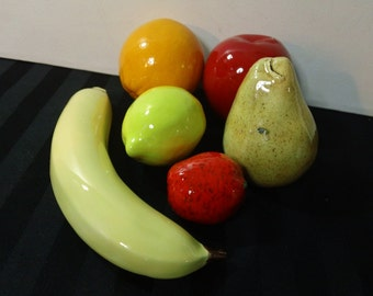 Six pieces of ceramic Imitation/Artificial Fruit (Banana, Orange, Lemon, Pear, Apple & Strawberry)