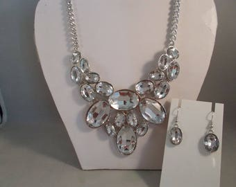 Silver Tone Bib Necklace with a Clear Crystal Pendant and Matching Earrings