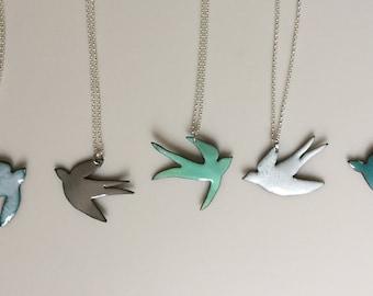 Pastel coloured enamel swallow necklaces