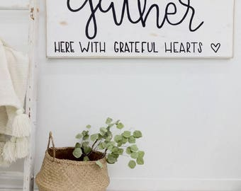 gather here with grateful hearts with heart black and white rustic wood sign