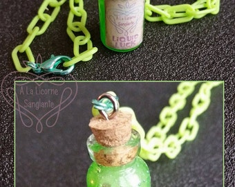 Has the Unicorn blood vial necklace Green