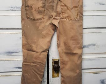 Vintage destroyed brown Levi's 511; W 36 - L 34; bleached