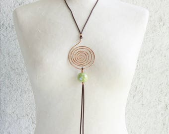 A copper necklace with a pendant totally handmade with pure copper wire and a Greek ceramic Lime green ball. A perfect gift for her