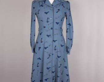 1970s ink blue hat and cat motif dress