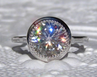 Forever One Moissanite Engagement Ring with White Gold Milgrain Bezel