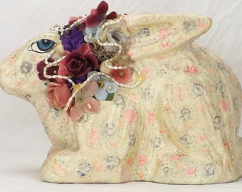 assemblage sculpture-paper mache bunny-rabbit sculpture-handmade mixed media-folk art sculpture-pastel hand painted-laying floral rabbit